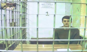 Yegor Zhukov, who was detained during a recent protest for fair elections, appears in a Moscow court via video link.