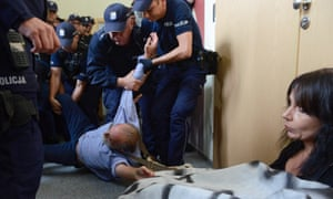 Protesters block the National Council of the Judiciary building in Warsaw