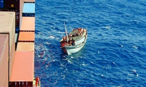 Indonesian ferry carrying 438 asylum seekers pulling along side the Norwegian cargo ship MS Tampa on 26 August, 2001.
