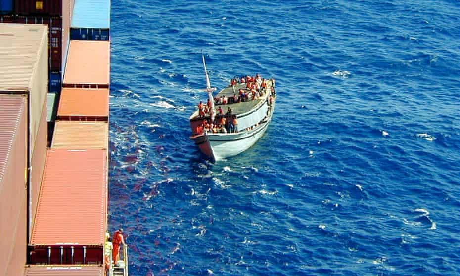 The Tampa pulls up alongside the sinking fishing vessel Palapa before the dramatic rescue of 433 asylum seekers.