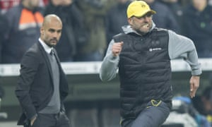 Klopp races past Guardiola to celebrate with his players at the end of the 2015 German Cup semi-final.