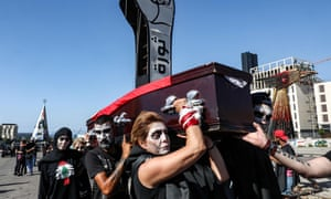 Anti-government protesters stage a symbolic funeral for the country in downtown Beirut