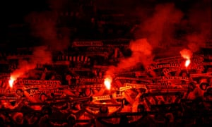 Young Boys fans set off flares inside the stadium.