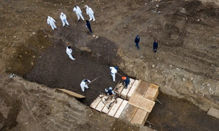 Drone pictures show bodies being buried on New York's Hart Island amid a surge burials during the Covid-19 outbreak on 9 April.