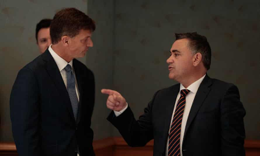 Federal minister Angus Taylor talking with the NSW deputy premier John Barilaro in 2019