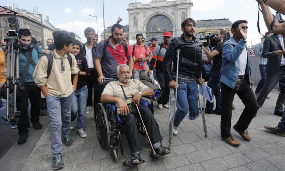 Refugees start to walk out of Budapest, Hungary