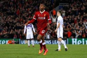 Liverpool's Daniel Sturridge celebrates scoring their third goal.