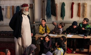 In a large house in southern Kabul, Abdul Baqi Samandar has built simple classrooms and workshops for street children.