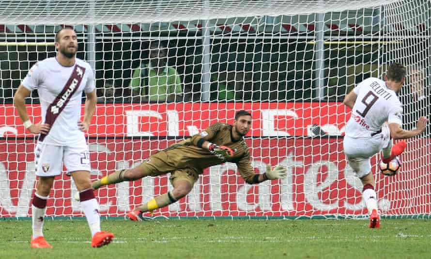 Milan goalkeeper Gianluigi Donnarumma saves Andrea Belotti's injury-time penalty.