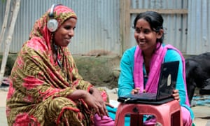 In Bangladesh, 'Info Lady' Mehedi Akthar Misty, right, helps Amina Begum, 45, to talk with her husband via Skype in a remote farming village 190km north of Dhaka