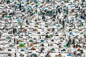 A snow-covered village with tiny candy- houses