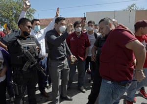 Mexican police detain a factory worker in Ciudad Juarez, after they halted their work to protest against the lack of safety measures.