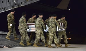 A US army carry team at Dover air force base, Delaware, transfers the remains of Staff Sgt Dustin Wright, who was among four special forces soldiers killed in Niger.