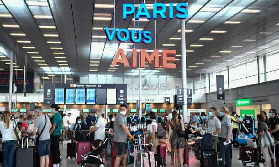 Travellers, wearing protective face masks, at Orly airport, France, on 1 August, 2020.