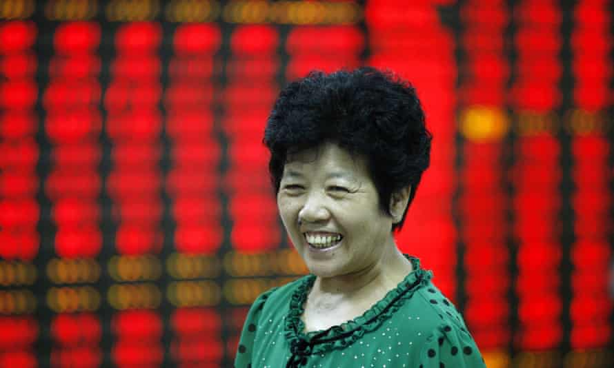 A Chinese investor smiles after stock markets rebound.