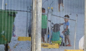 Children playing near a fence at the Australian-run detention centre on Nauru