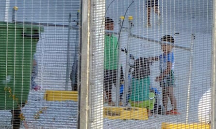 An undated image from Amnesty International showing children playing near a fence at the regional processing centre in Nauru.