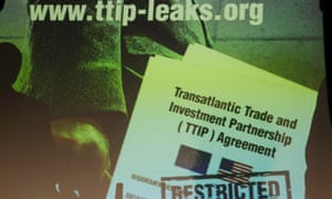 A copy of the leaked TTIP talks is projected onto a screen at a Greenpeace news conference in Berlin