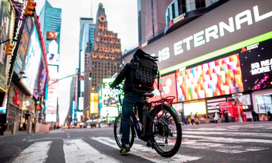 A cyclist delivering food in an empty Times Square in Tuesday in New York City.