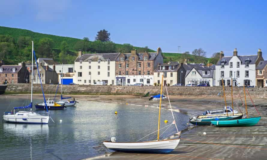 Sailing boats at low tide in Stonehaven, Aberdeenshire, Scotland, UK.