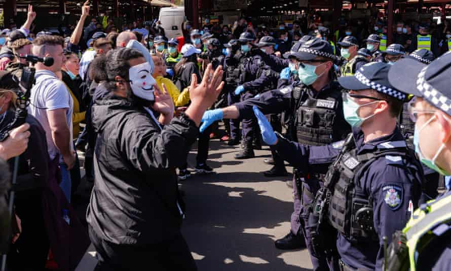 Anti-lockdown protesters face police in Melbourne last weekend