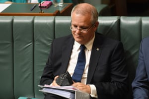 Scott Morrison looks at a piece of coal in Parliament House in Canberra. His government has no policies to deliver on Paris agreement commitments.