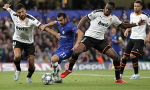 Chelsea's Pedro, centre, is crowded out by Valencia's Geoffrey Kondogbia, right, and Ezequiel Garay.