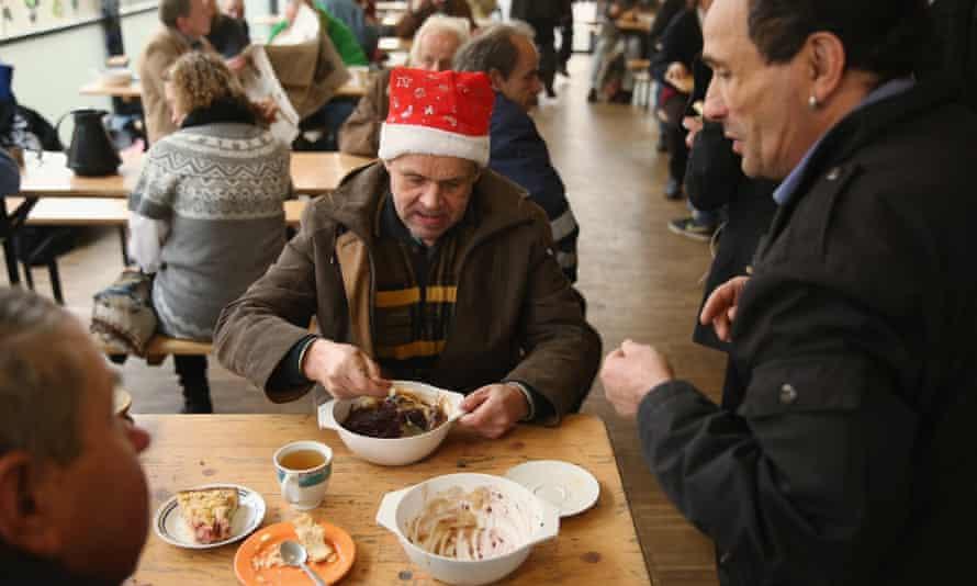 A man enjoys a hot meal