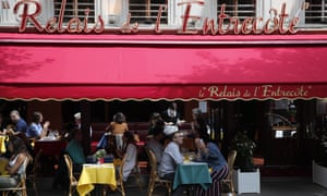 Customers take a selfie as they enjoy a lunch at a restaurant, in Paris, Monday, 15 June, 2020.
