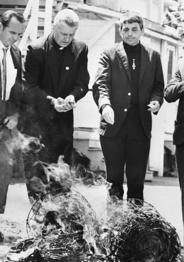 Daniel Berrigan, right, and his brother, Philip Berrigan, burning draft board records in 1968.