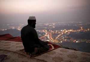 A Muslim pilgrim prays on top of Mount Thawr