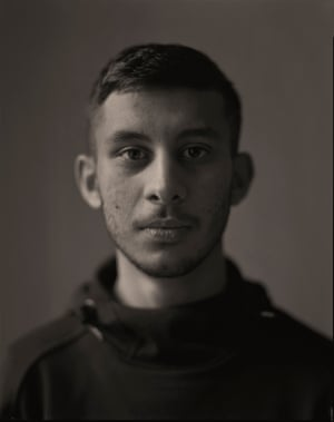 A black and white portrait of Awais from Lancashire