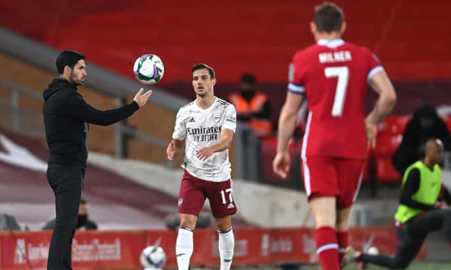 Mikel Arteta gets involved in the action at Anfield
