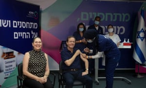 Israeli president Isaac Herzog receives a third dose of Covid-19 vaccine on Friday.