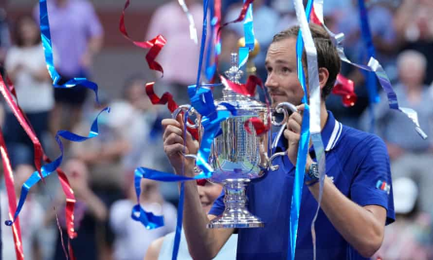 Daniil Medvedev celebrates with the US Open championship trophy after beating Novak Djokovic in the final.