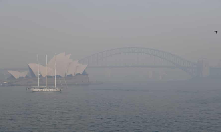 harbour bridge and opera house in smoke haze