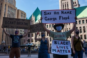 Protesters gather in a call for justice for George Floyd at Hennepin county government plaza in Minneapolis.