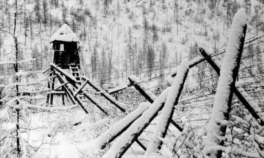 Barbed wire fence and guard tower at a disused Stalinist convict camp, Siberia, Russia, 1989.