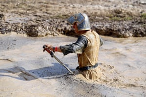 A runner wearing a medieval knight costume takes part in mud day, a 13km race with obstacles in Beynes.