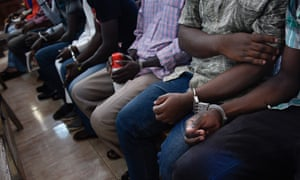 Suspects involved in sexual and gender-based violence cases attend a special session at the Kampala high court in Uganda