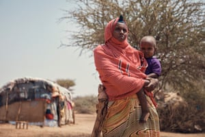 SomalilandFarmer Muna Yusuf Adan, 29, lives with her husband, five children, and disabled brother-in-law. Their home is surrounded by arid land, it is extremely windy and there are dead animal carcasses only metres away.