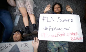Tiara Marshall joins people lying in an intersection during a demonstration in Los Angeles, California