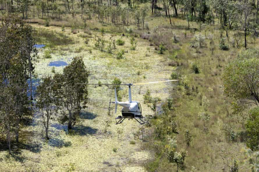 Rangers travelling by helicopter to to a remote site in the south of the Warddeken IPA.