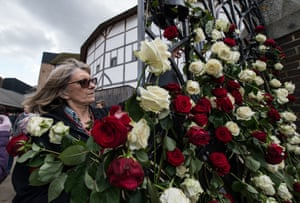 Roses are placed in the gate of the Globe Theatre in London