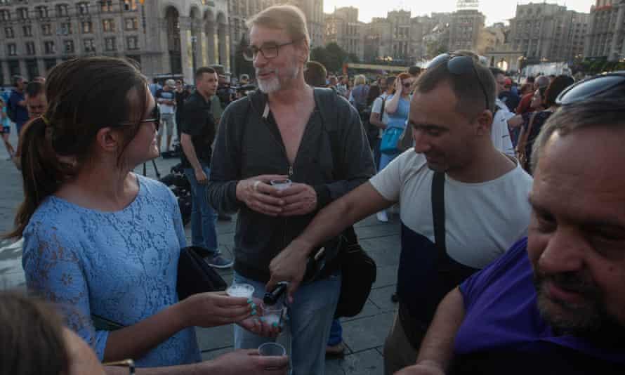 Journalists drink champagne in Kiev