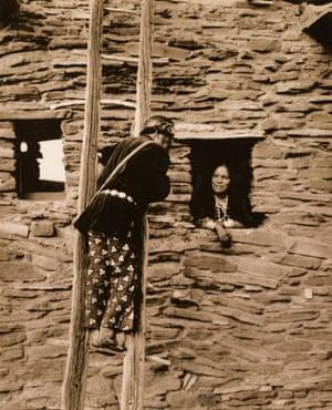 A man and woman at the Hopi House, circa 1920.