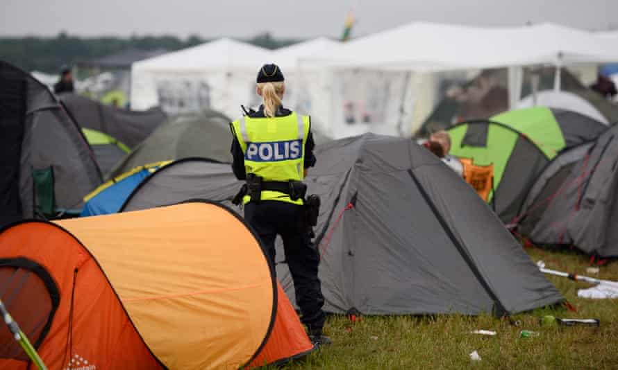 A police officer guards a campsite during the Bråvalla festival in Sweden.