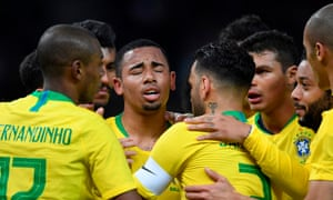 Gabriel Jesus is embraced by his Brazilian team-mates after scoring against Germany.