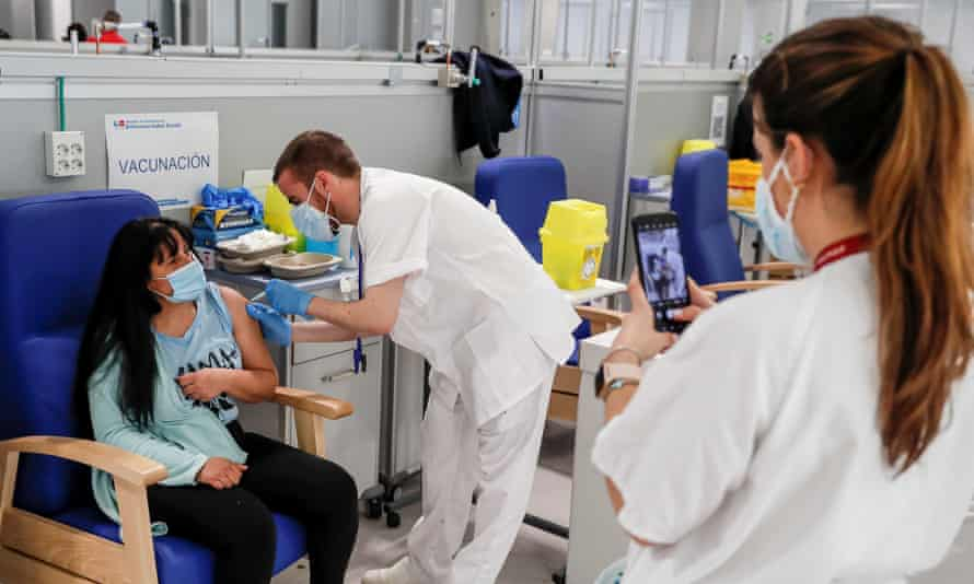 A health worker administers a dose of the AstraZeneca vaccine at Isabel Zendal hospital in Madrid