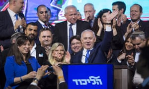Benjamin Netanyahu, his wife, Sara and Likud party members greet supporters during Likud's party as the country waits to hear election results.